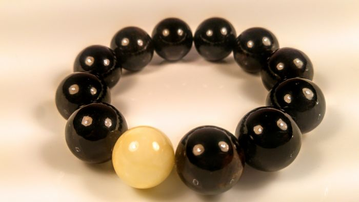 Black colour Baltic amber Bracelet with white amber accent, hand hole ca. 60 mm, 57 grams