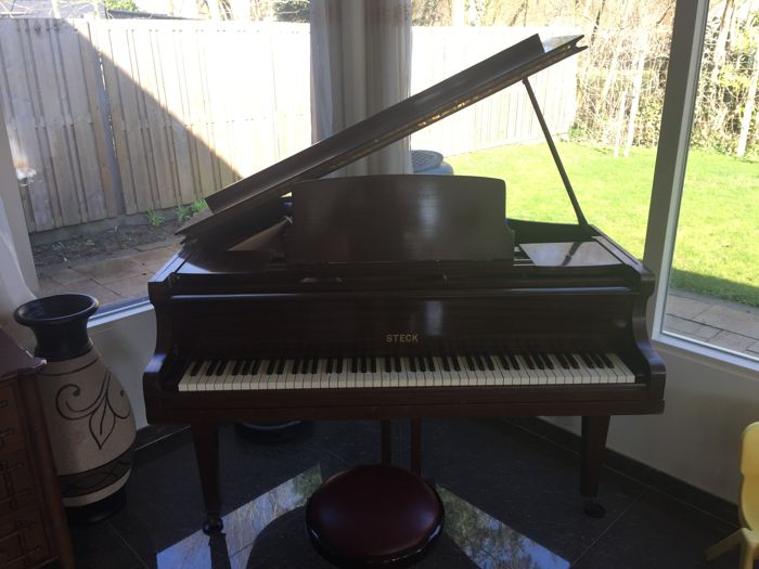 Steck concert piano, including hydro cell and matching bench