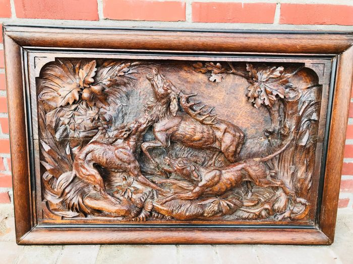 A large and detailed wooden relief with a deer that is being attacked by two dogs - presumably Germany/Switzerland - 19th century