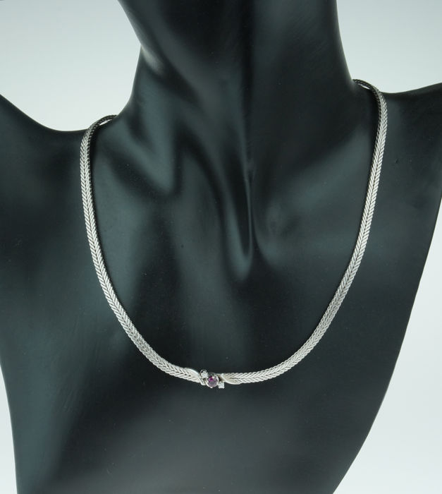 14 kt white gold necklace braided link set with diamonds and ruby