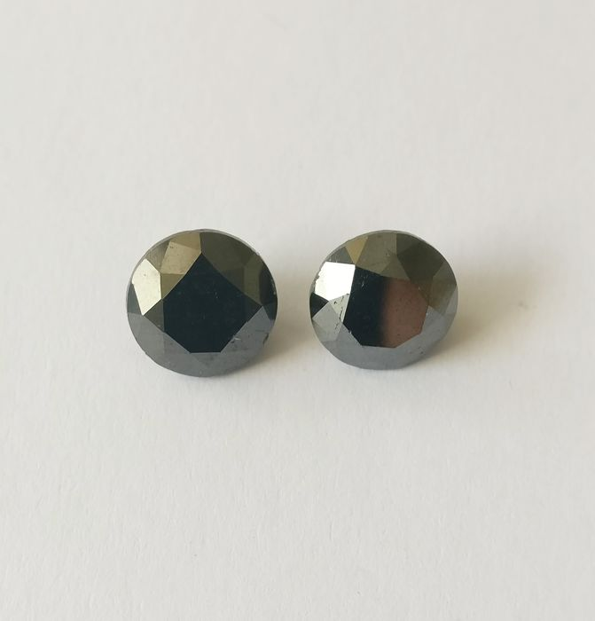 Couple of 2 Round cut diamonds total 8.38 ct Fancy Black