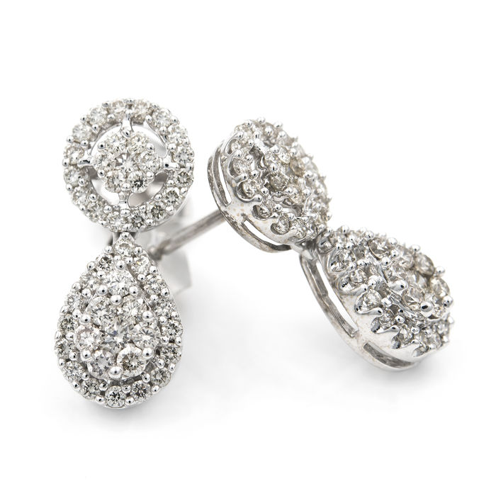 Tear drop-shaped earrings with white gold stud setting and brilliant cut diamonds