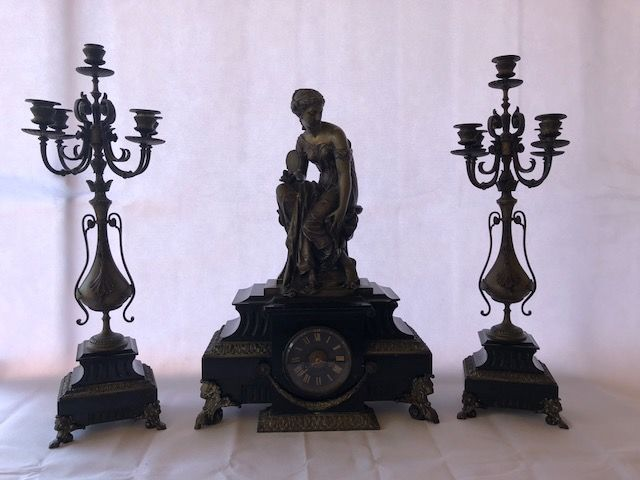 Mantel clock with bronze statue and candelabra by Michaudet of   Saint-Chamond
