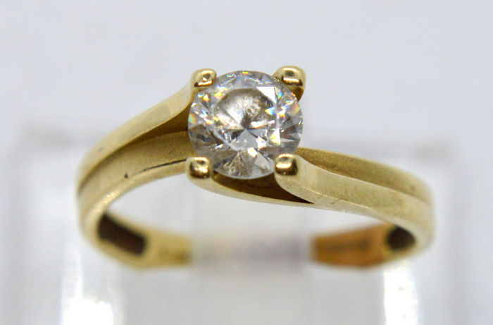 14 ct. / 585 Gold Ring with 0.75 ct big natural zirconia, total weight 2.56 gr - size 54
