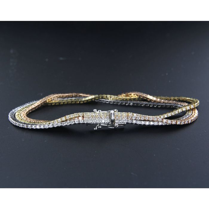 14 kt white, rose and yellow gold tennis bracelet consisting of three rows and set witha total of 285 brilliant cut diamonds