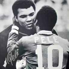 Iconic photo/poster of Muhammad Ali and Pele, signed by Pele + Certificate of Authenticity PSA/DNA COA