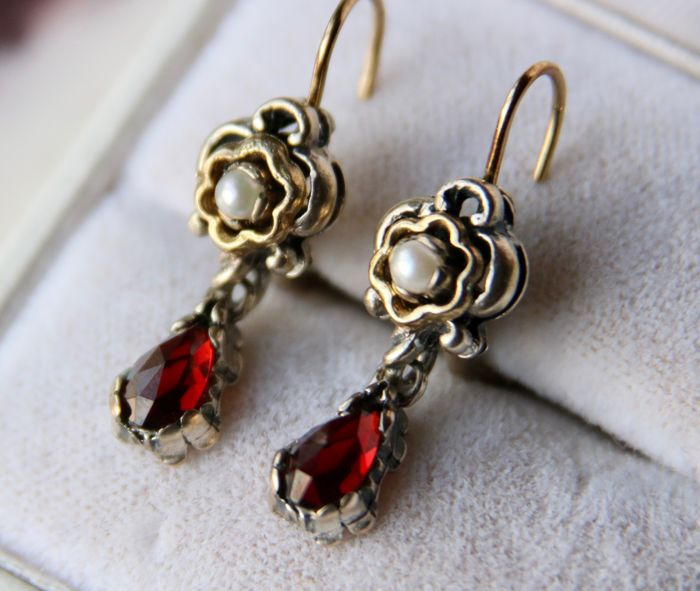 Antique partially gold-plated silver earrings set with old cut Garnets and seed pearls in an excellent state **No reserve**