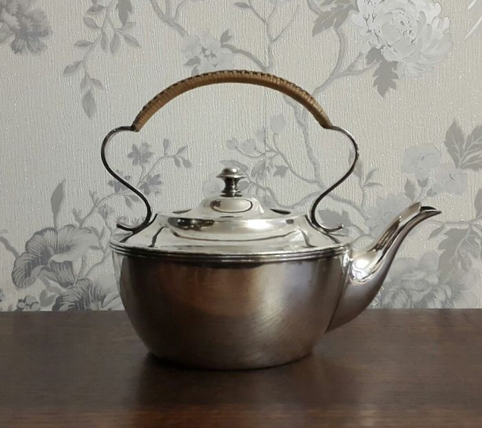 Antique silver plated kettle with a wicker handle, by James Deakin & Sons.