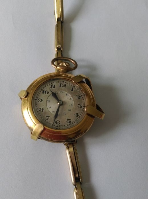 rare pocket watch guaranteed gold plated /2 in 1 of the 'Poilus' WW1, can turn into wrist watch, works