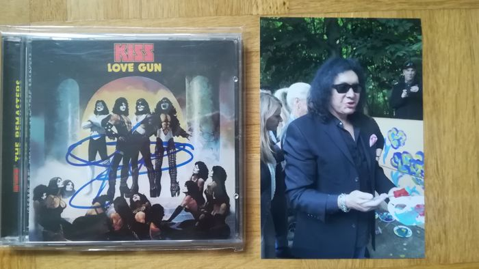 Kiss CD, Love Gun, mint and signed by Gene Simmons