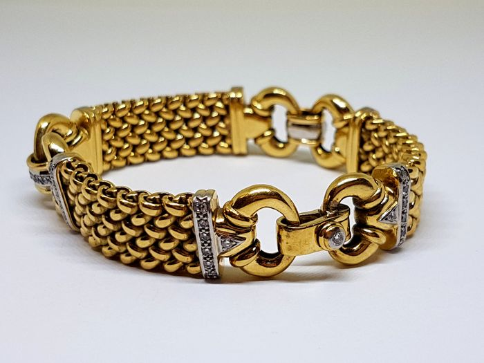 Two-tone 18 kt gold bracelet, 60 g - 0.63 ct total of Diamonds - 19 cm