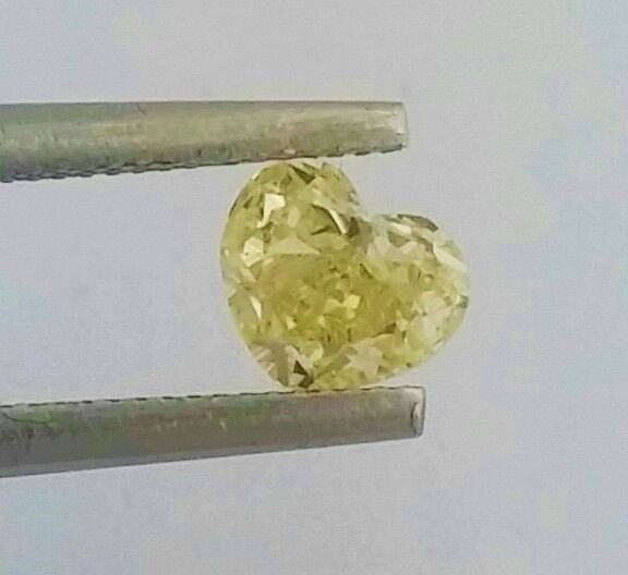 0.61 carat - Natural Fancy Intense Yellow - VS2 clarity - Heart Cut  - Comes With AIG Certificate + Laser Inscription On Girdle.