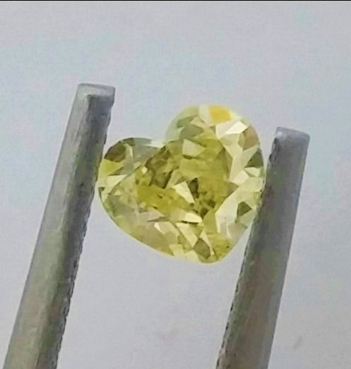 0.44 carat , Heart Diamond , Natural Fancy Intense Yellow , VS1 clarity , Big AIG certificate + Laser Inscription on Girdle .