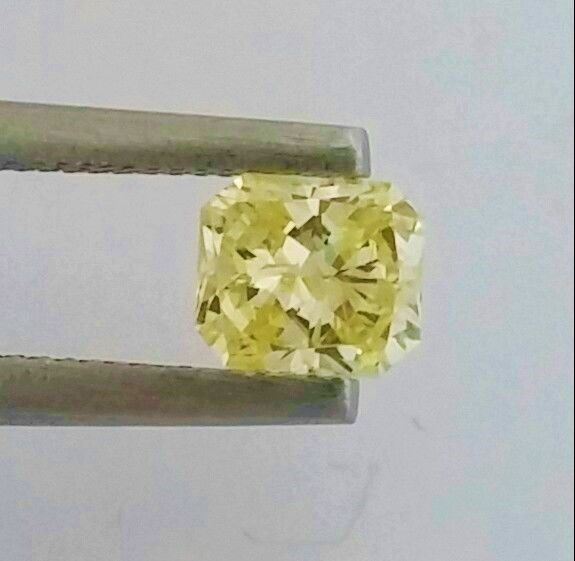 Radiant Cut  - 0.50 carat  - Natural Fancy Intense Yellow  - SI1 clarity  - With AIG Big Certificate + Laser Inscription On Girdle