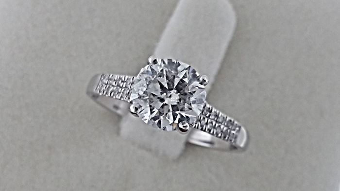 1.64 TCW Round treated Diamond Engagement Ring in 14 kt White Gold