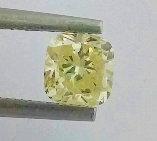 0.84 ct - SI1 - Cushion - Natural Fancy Yellow Diamond - AIG Certified + Laser Inscription On Girdle.