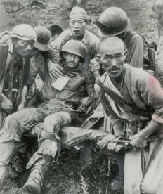 David Douglas Duncan (1916-)/AP - 'A wounded American soldier carried by South Koreans', 1950