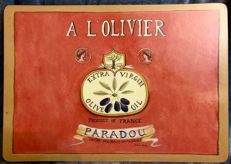 """A vintage , French ,  wood ,  advertising , panel cartel ,"""" PARADOU """" , """" A L´OLIVIER """" , Extra Virgin Olive Oil  , decorated with olives in red background"""