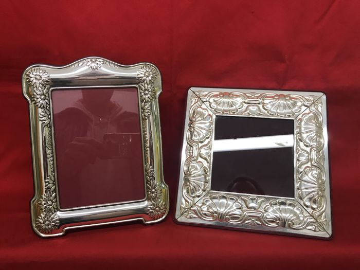 A pair of silver laminated frames, hallmarked, with decorations in relief