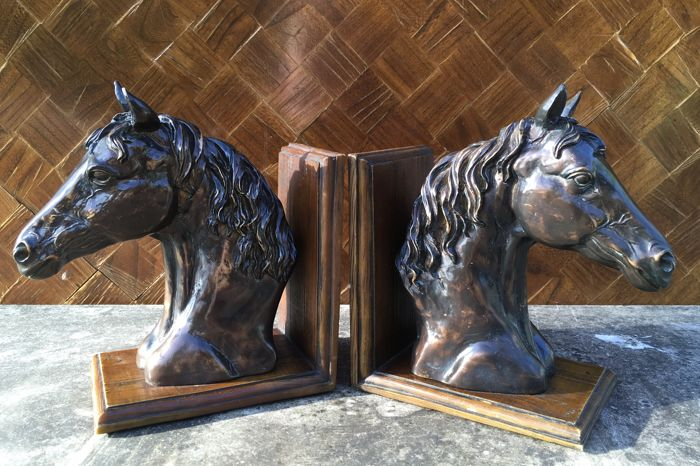 A vintage set of bookends with horse heads