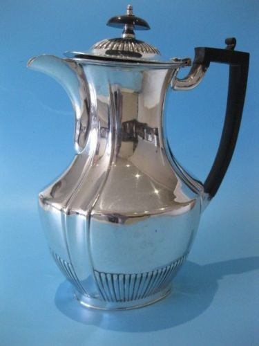 Large silver-plated coffee pot with Bakelite handle, by Pinder Brothers 1910