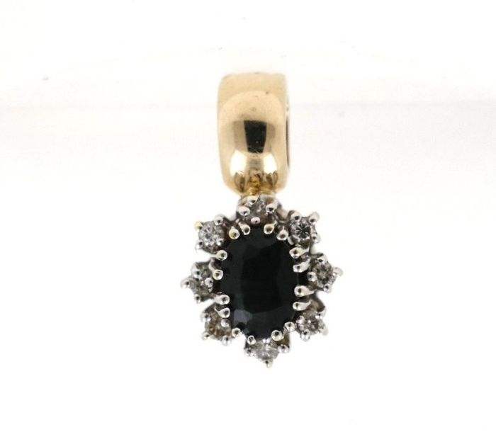 14 kt clip-on pendant with a total of 0.20 ct of diamonds and 1.0 ct central sapphire - size: 19.21 x 10.45