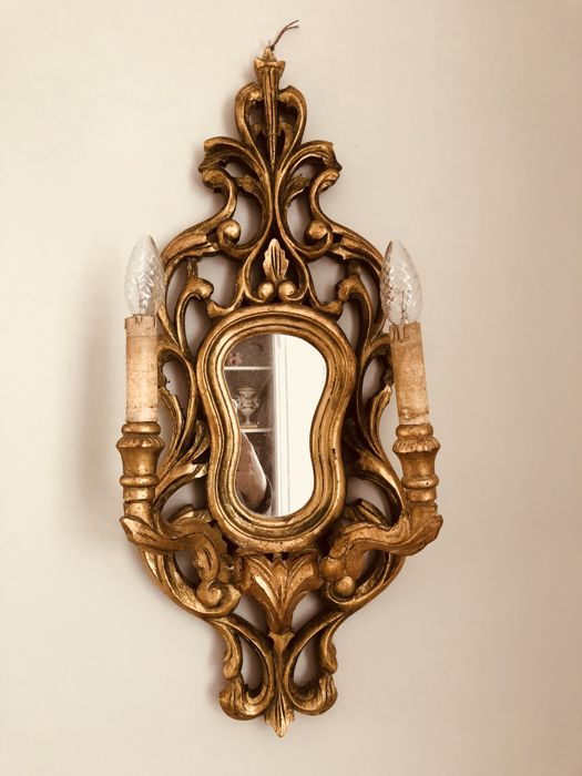 A beautiful hand carved mirror baroque with lighting wall lamp