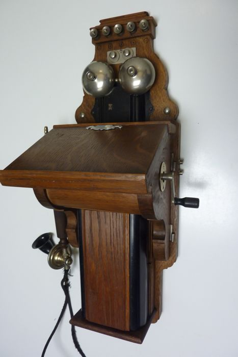 A wooden wall phone, LM Ericsson Magneto Telephone, Sweden, 1921