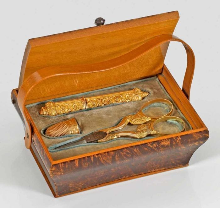 A gold sewing bag in an edged walnut case, France ca. 1840