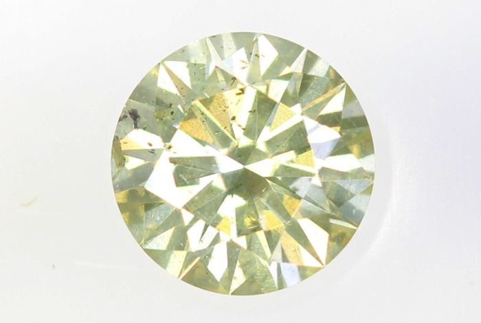 AIG Sealed Diamant - 0.31 ct - Fancy Light Greenish Yellow - Excellent Cut - SI2