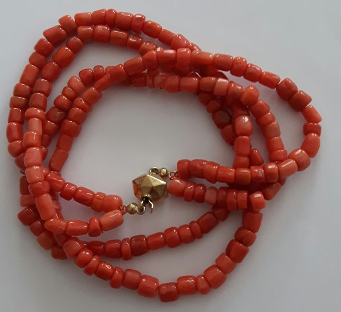 Necklace of 2 rows of natural Red coral with an antique 14 karat Gold barrel clasp
