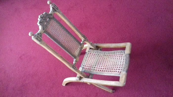 A folding high chair, early 20th century