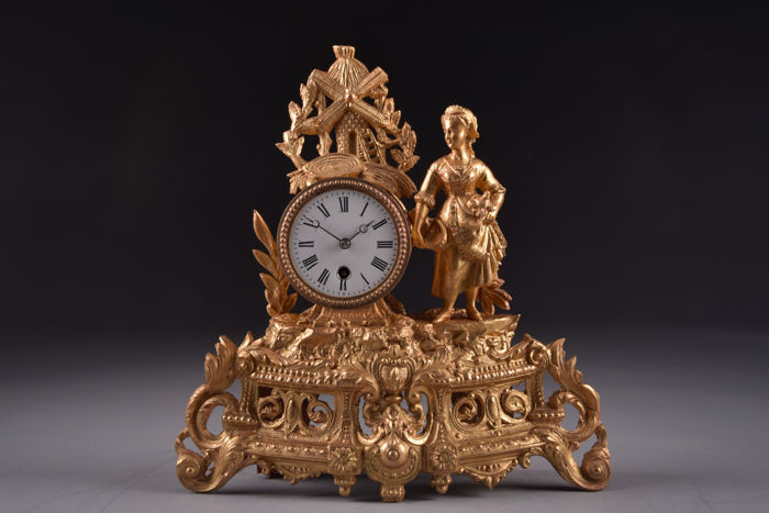 Beautiful French gold plated clock with image of a mill and farmer's wife - France approx. 1880