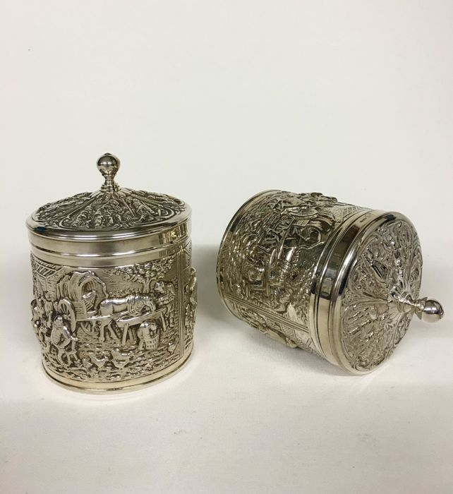Two decorated tea containers or storage containers designed by H