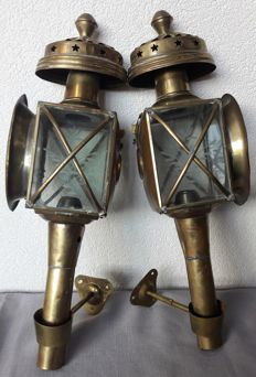 A pair of brass carriage lanterns