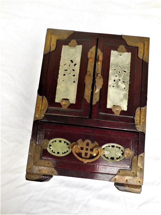 Old wooden cabinet /jewellery box, carved with jade inlay, key/bronze fitting and satin upholstery
