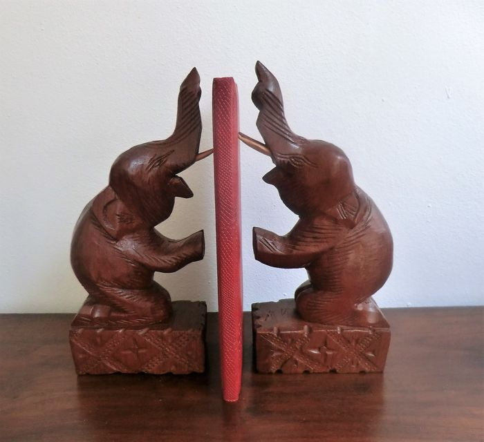 Hand carved solid teak wood group of an elephant family on a bridge