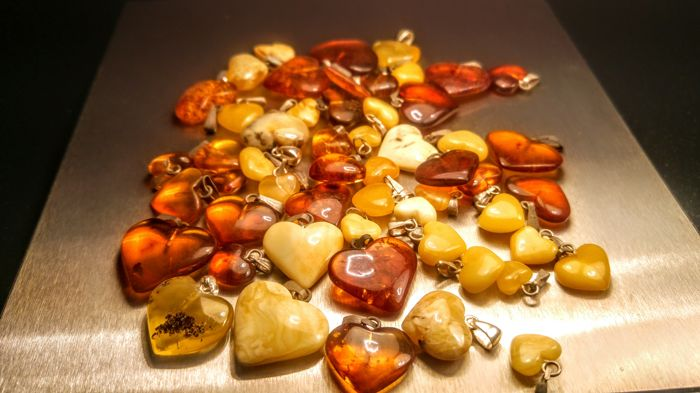 Vintage Egg yolk- Cognac colours Baltic Amber heart pendants, lot of 54 pieces