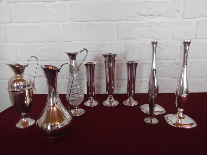 Collection of nine classic silver plated rose vases in several designs