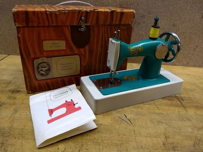 A Russian 3MU toy sewing machine, 1960's, boxed, manual.