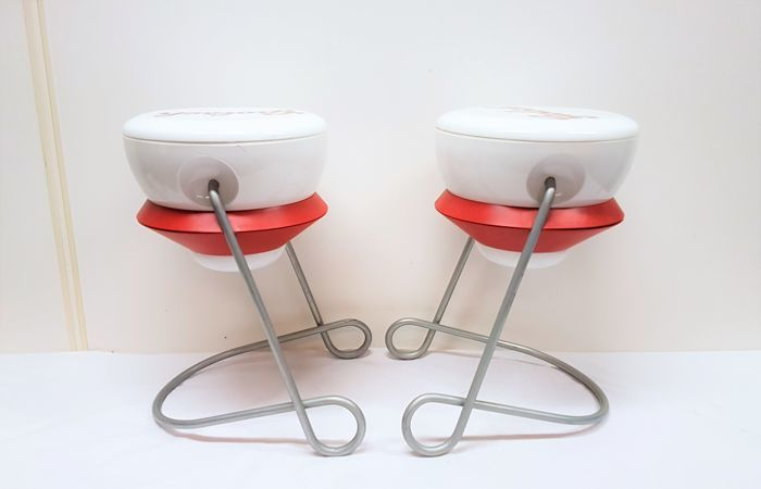 Two pieces Grolsch side tables