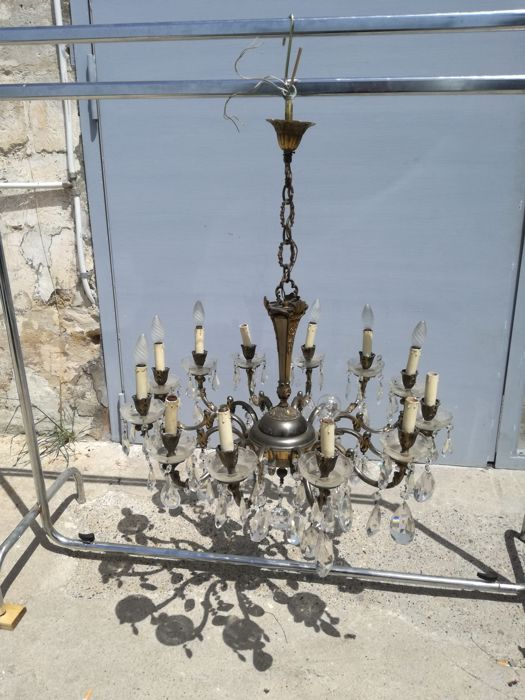 Chandelier in worked brass and cut crystal - 20th century