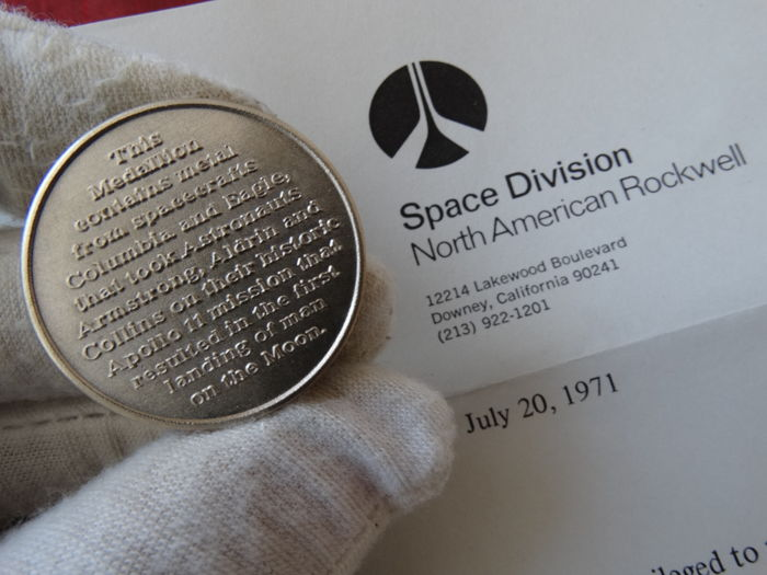 Authentic Apollo 11 this material went to the moon and it came backcontains metal taken from the Apollo 11 command and lunar modules
