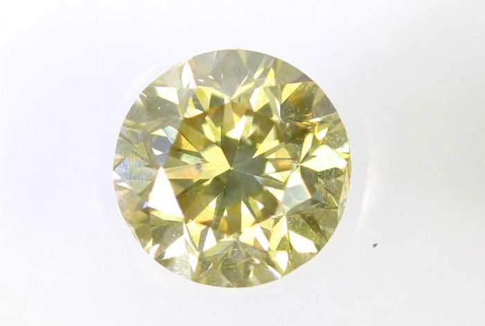 AIG Sealed Diamond - 0.49 ct - Fancy Light Brownish Yellow - SI1