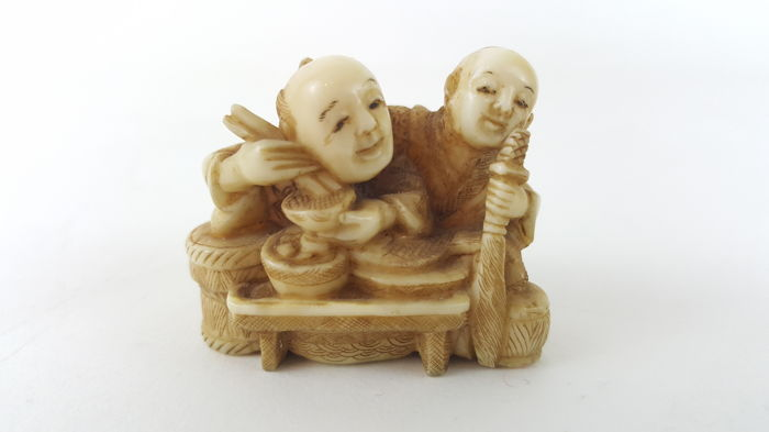 Ivory netsuke of Father & son by table - Japan - ca. 1900