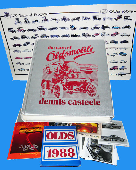 """The cars of Oldsmobile"" book followed by three big 1987 brochures, a 100 years anniversal press kit (1997), and a 1988 press kit"