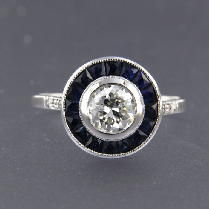 Platinum ring set centrally with a 0.72 ct Bolshevik cut diamond surrounded by princess/taper shape cut sapphire and single cut diamond, ring size 17.25 (54)