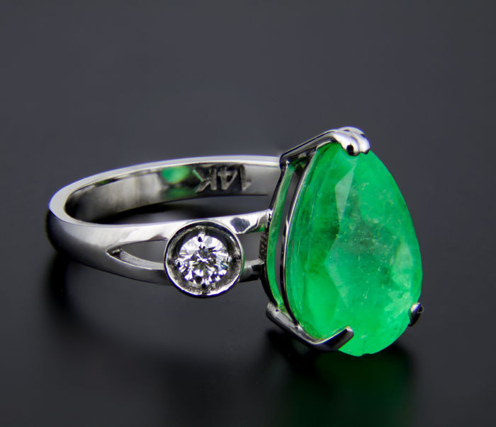GIA Certified 4.90 ct. Emerald And Diamonds White Gold Ring.