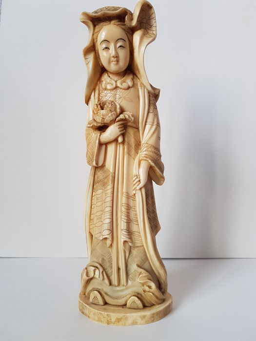 Marine ivory Kannon/Guanyin with flowers - Japan - c. 1900