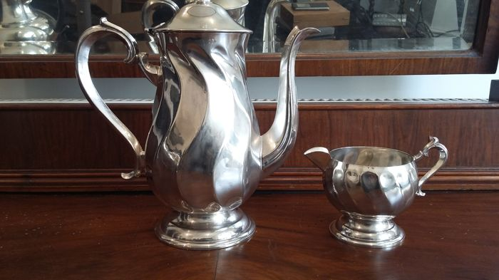 Art Nouveau silver plated EPNS tea pot and milk jug made in england.